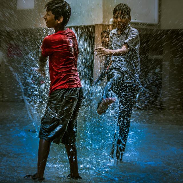 """Children were Playing Football in Monsoon Rain"" stock image"