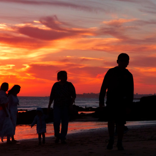 """Sunset beach family walking on the sand on a summer day"" stock image"