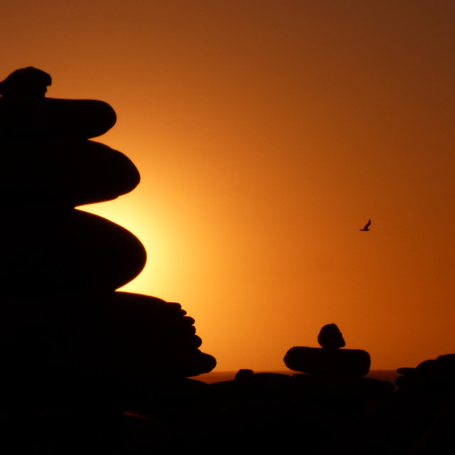 """Zen rocks at sunset silhouettes"" stock image"