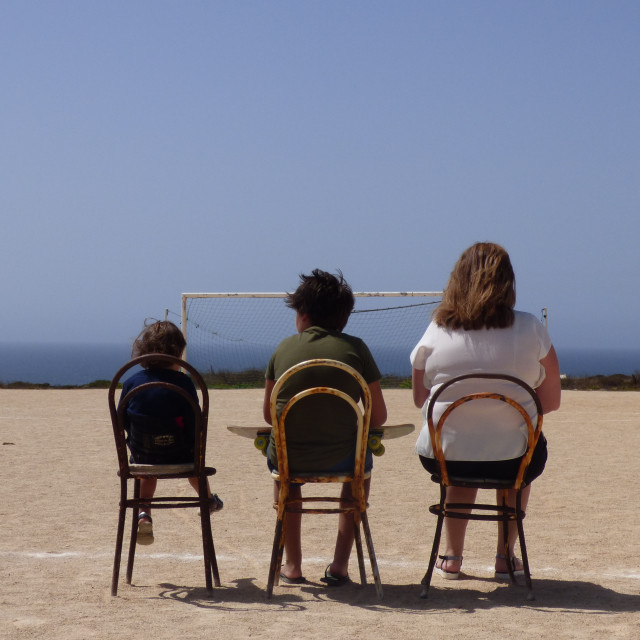 """Family sitting on rusty chairs"" stock image"