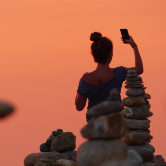 """young woman taking a selfie on the beach"" stock image"