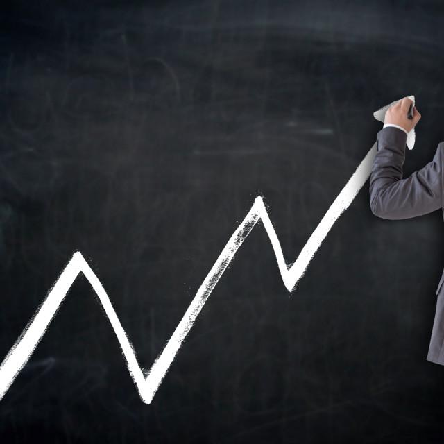 """Business man writes index on blackboard concept"" stock image"