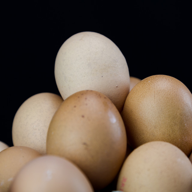 """Light brown eggs place in pyramid shape"" stock image"