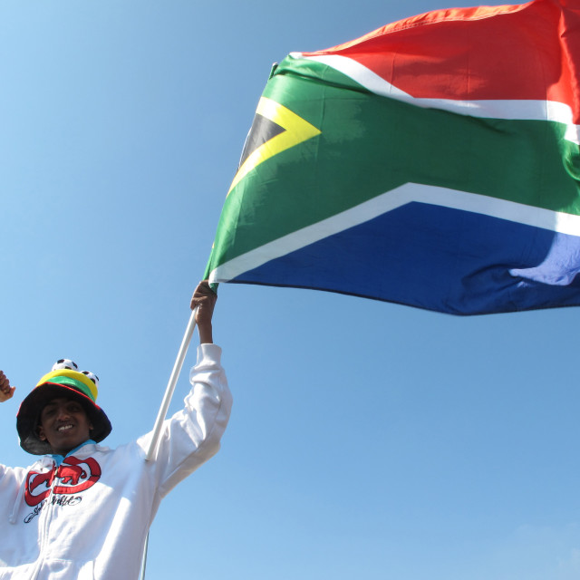 """South African fan celebrates with pride and passion holding a vuvuzela..."" stock image"