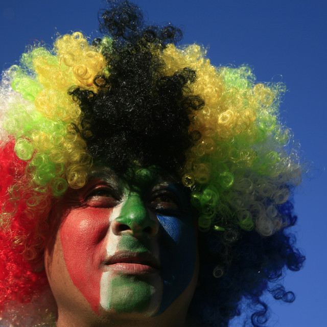 """""""South African fan celebrates at Grand Parade fan park with pride and passion..."""" stock image"""