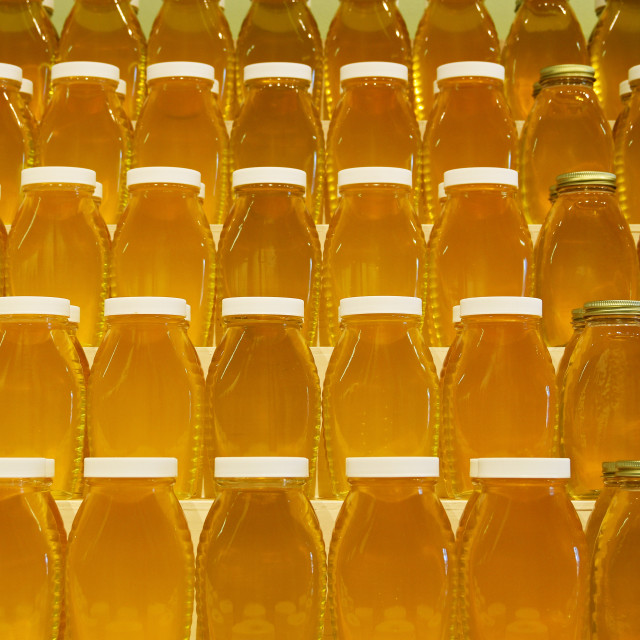 """Jars of honey on shelves"" stock image"
