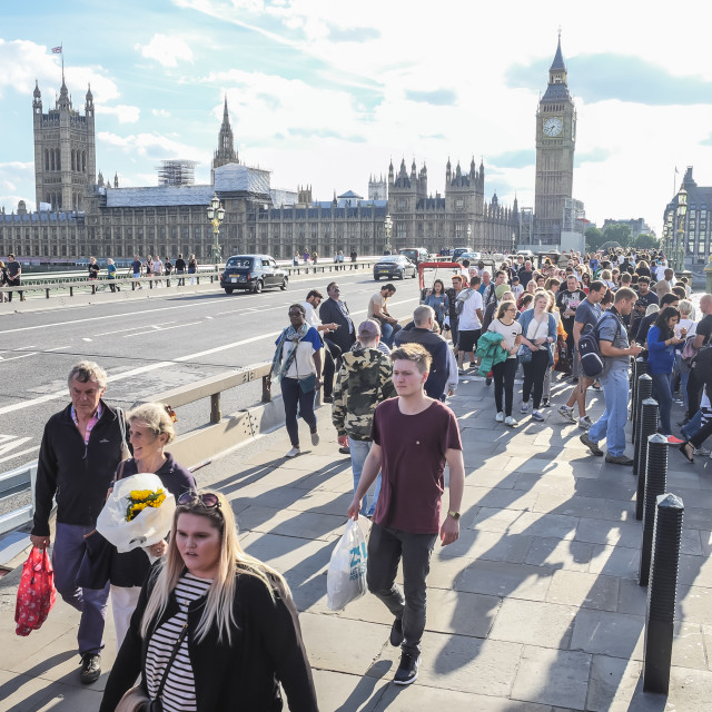 """People walking along Westminster Bridge"" stock image"