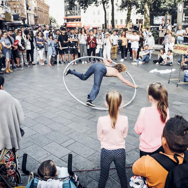 """""""Street Artist Performing in Cyr Wheel"""" stock image"""