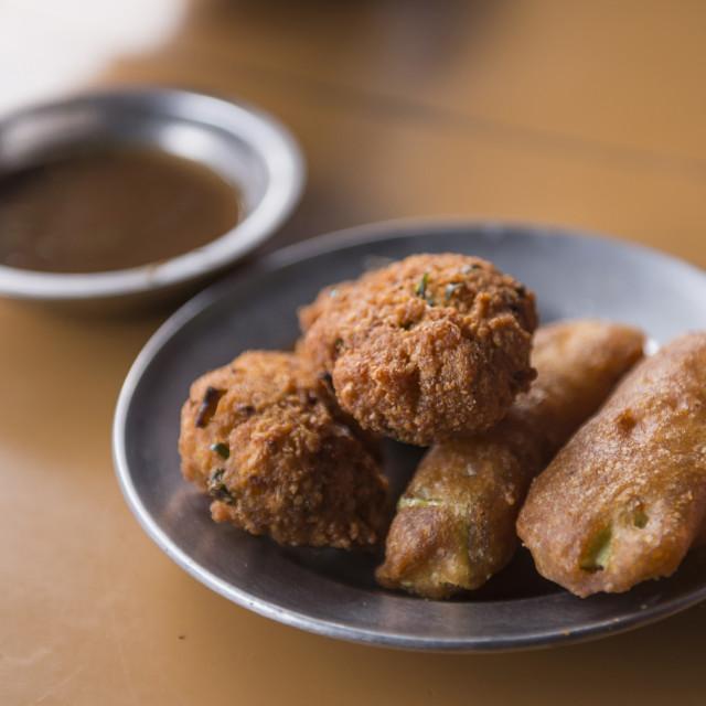 """Deep fried aubergine, a Burmese breakfast in Kalaw market, Shan State,..."" stock image"