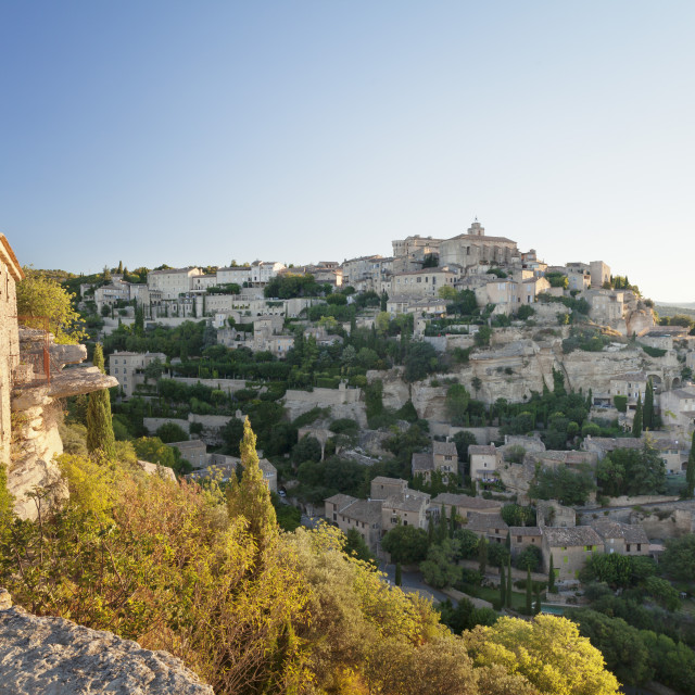 """""""Hilltop village of Gordes with castle and church at sunrise, Provence,..."""" stock image"""