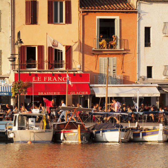 """""""Fishing boats at the harbour, restautants and streetcafes at the promenade,..."""" stock image"""