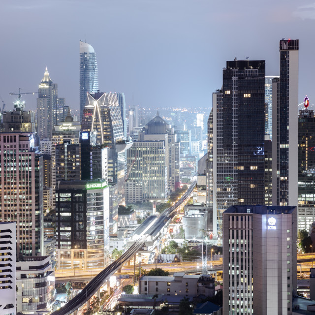 """Skyline showing the Skytrain and city centre around Sukhumvit Road and Chit..."" stock image"