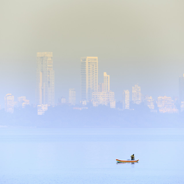"""A fisherman in front of the skyscrapers of the Malabar Hills in Mumbai..."" stock image"