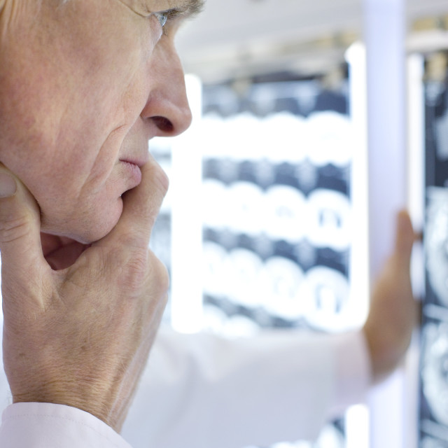 """""""Radiologist studying CT scans"""" stock image"""
