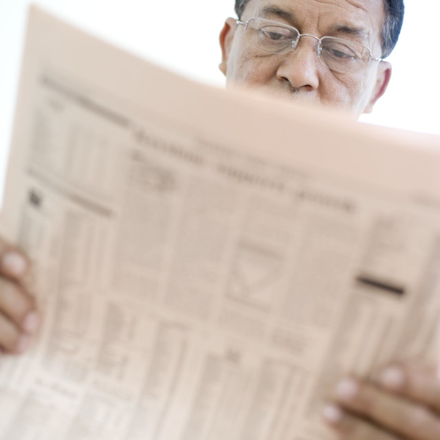 """Man reading a newspaper"" stock image"