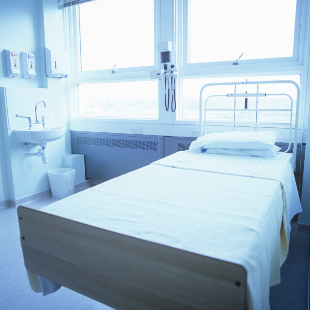 """Empty hospital bed"" stock image"