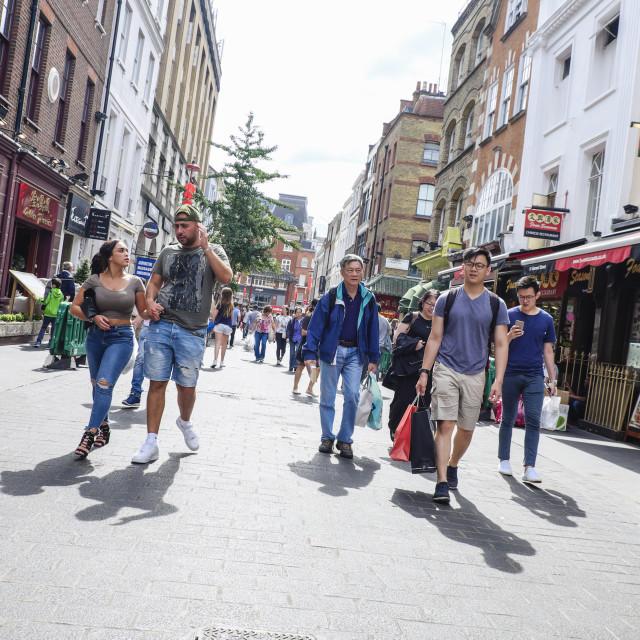 """People walking along Chinatown London"" stock image"