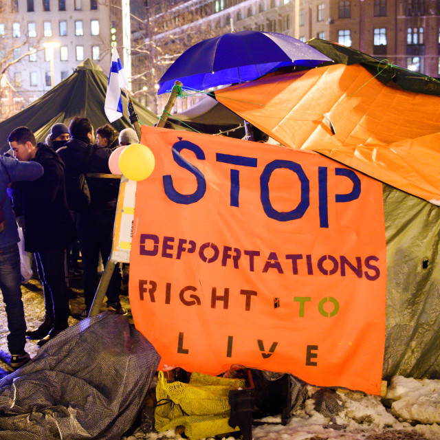 """February 27, 2017. Helsinki, Finland. People protesting against deportation with slogan and flag of Finland on tents,near Central Train Station in Helsinki,Finland"" stock image"