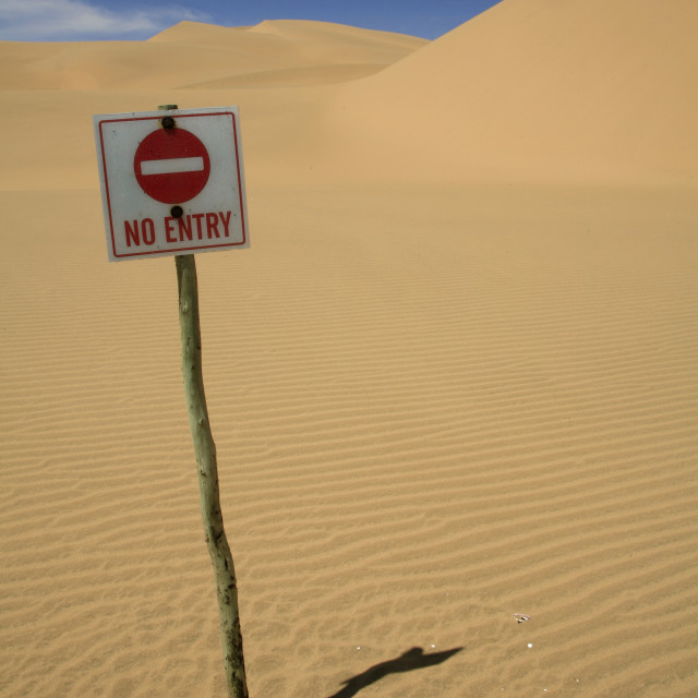 """no-entry sign near sand dunes in Namib Desert, NamibiaMarch 26, 2010{iptc..."" stock image"