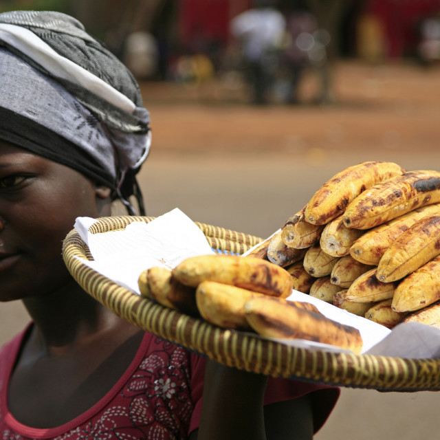"""African woman selling fried bananas at a bus window, UgandaNovember 23,..."" stock image"