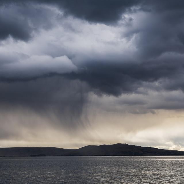 """Dramatic storm clouds over Lake Titicaca, Peru"" stock image"