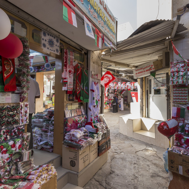 """Flags and other Oman National Day decorations for sale at Mutrah Souq,..."" stock image"
