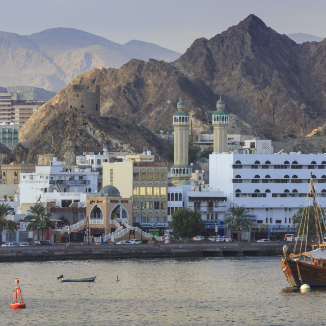 """Mutrah Corniche and entrance to Mutrah Souq, backed by mountains, viewed from..."" stock image"