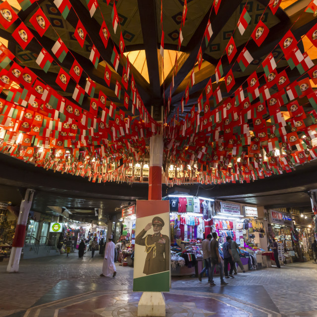 """Flags and Sultan's portrait decorate Mutrah Souq for Oman National Day, 18..."" stock image"