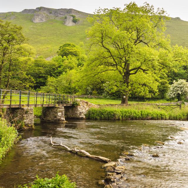 """Bridge across River Wye, stone farm buildings, Monsal Dale, spectacular..."" stock image"