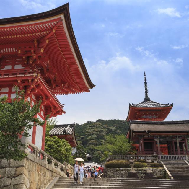 """Visitors with sun umbrella, vermillion temple entrance buildings,..."" stock image"
