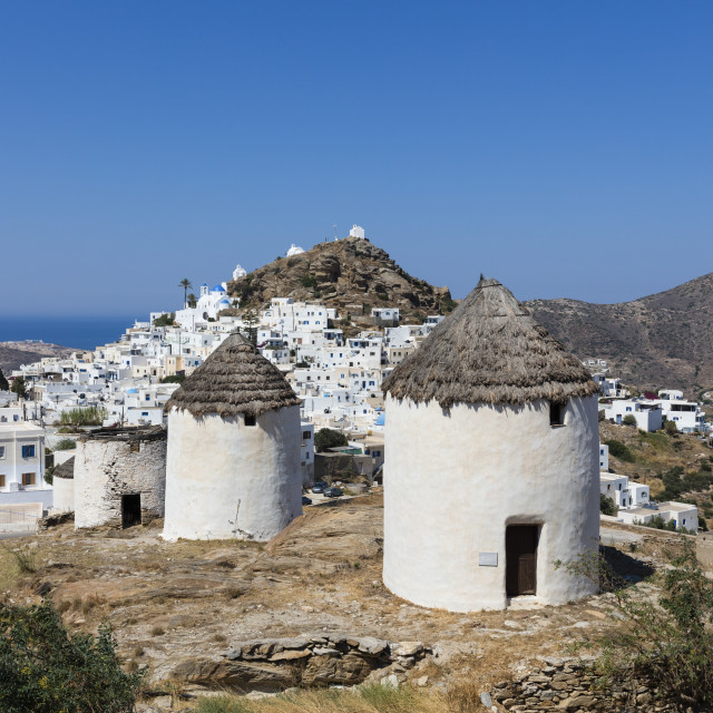 """A typical greek village perched on a rock with its white and blue houses and..."" stock image"