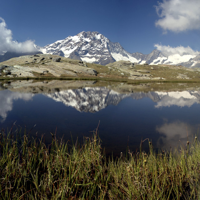 """Panorama of Mount Disgrazia reflected in the lake Vazzeda, Alpe Fora, Malenco..."" stock image"