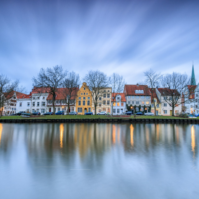 """""""Clouds on the typical houses and towers of cathedral reflected in River Trave..."""" stock image"""