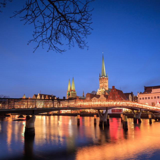 """""""The lights of dusk on typical bridge and the cathedral reflected in River..."""" stock image"""