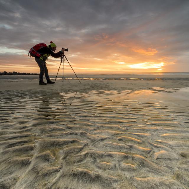 """""""Midnight sun frames photographer in action on Skagsanden beach, Ramberg,..."""" stock image"""