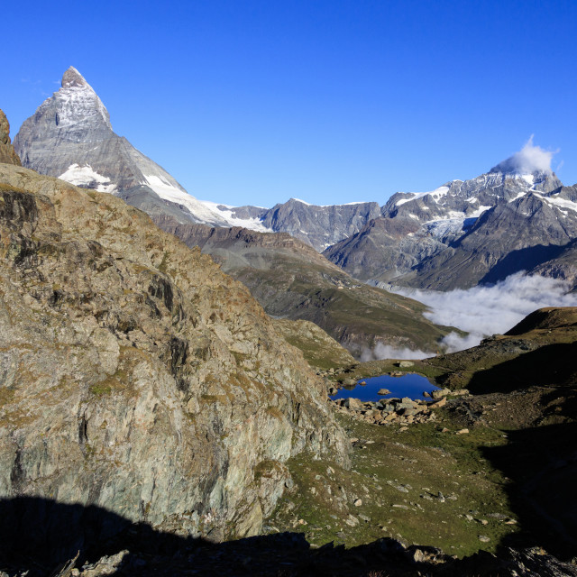 """Matterhorn and Dent Blanche and the blue waters of Lake Riffelsee Zermatt..."" stock image"