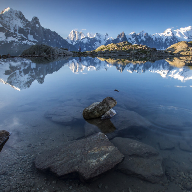 """Snowy peaks of Aiguilles Verte Dent Du Geant and Mont Blanc are reflected in..."" stock image"