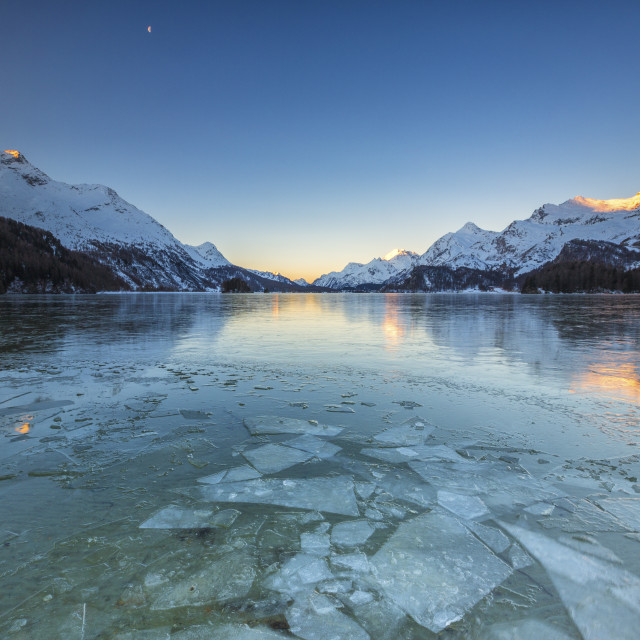 """Sheets of ice on the surface of Lake Sils in a cold winter morning at dawn..."" stock image"
