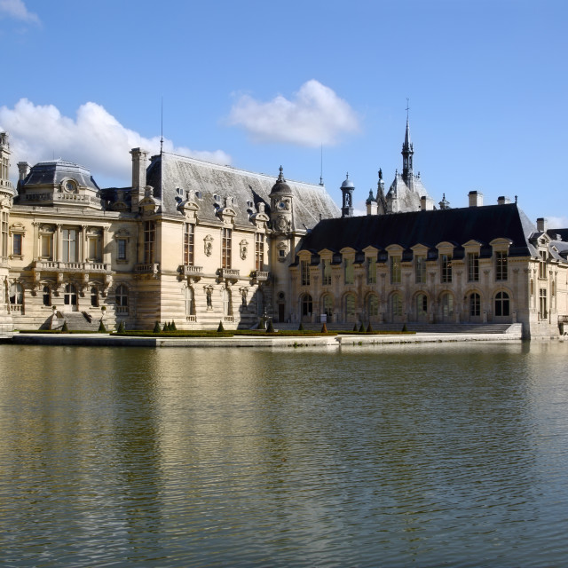 """Chateau Chantilly across the moat, Chantilly, Oise, France"" stock image"