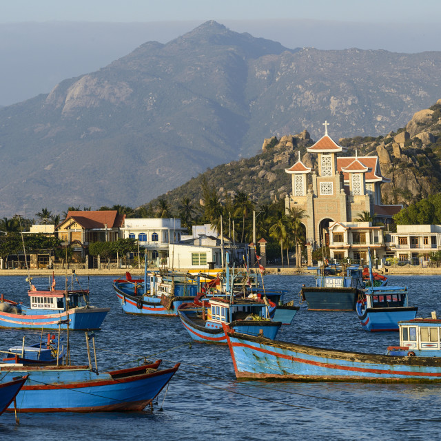 """""""The fishing port with the church in the background, Phan Rang, Ninh Thuan..."""" stock image"""