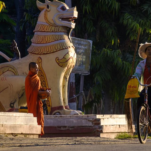 """Monk collecting alms, Mandalay, Myanmar (Burma), Asia"" stock image"