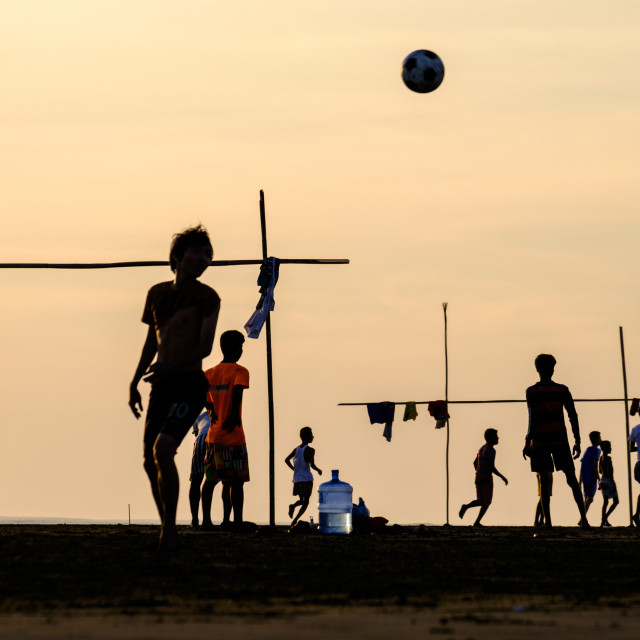 """""""People playing football at Viewpoint, a panorama on the Kaladan river,..."""" stock image"""