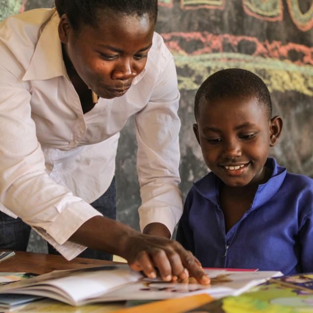 """ISINGIZWE Alice 8 years old who is dumb and her teacher MUSABYEMARIYA..."" stock image"