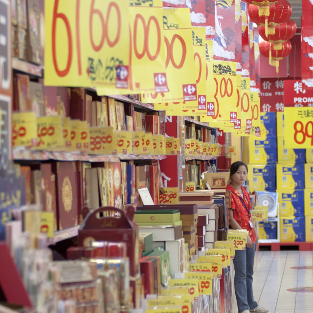 """""""Supermarket worker selling promotions; consumerism in the new China"""" stock image"""