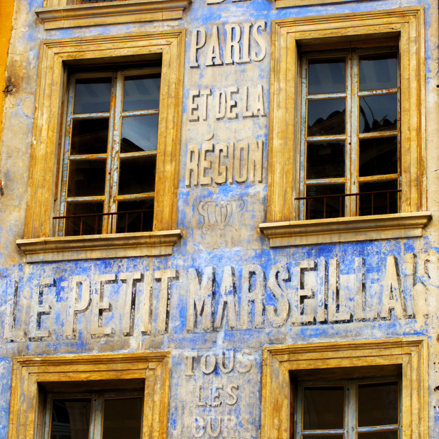 """Old Newspaper mural advert, PRovence"" stock image"