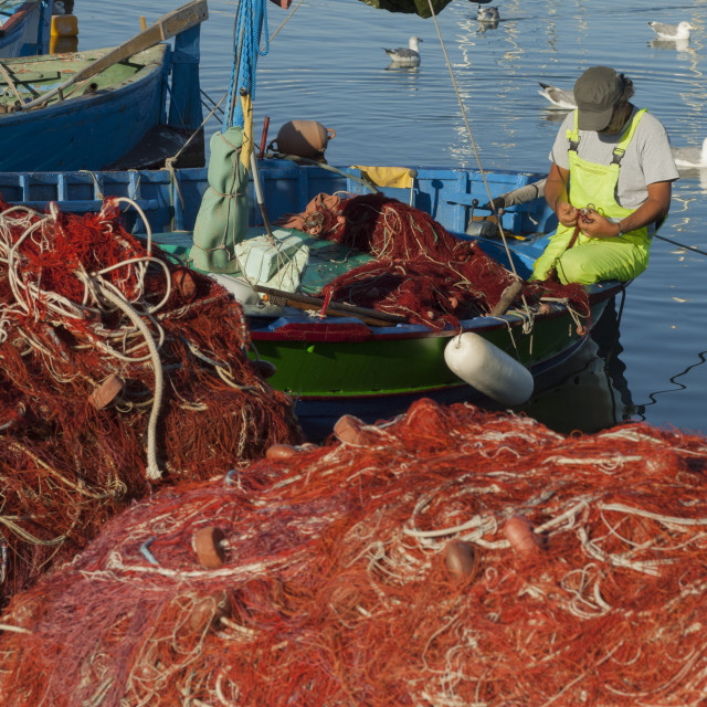 """Fisherman mending nets, Alghero, SardiniaSardinia"" stock image"