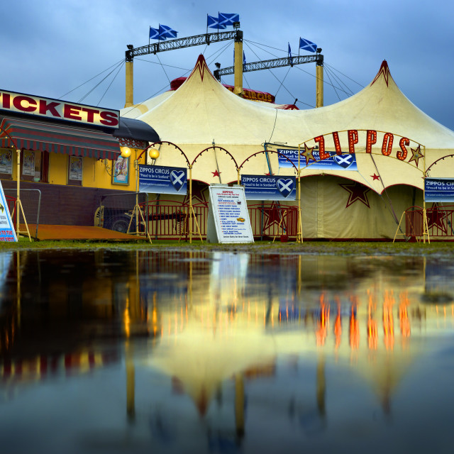 """Circus big top tent in a flooded field"" stock image"
