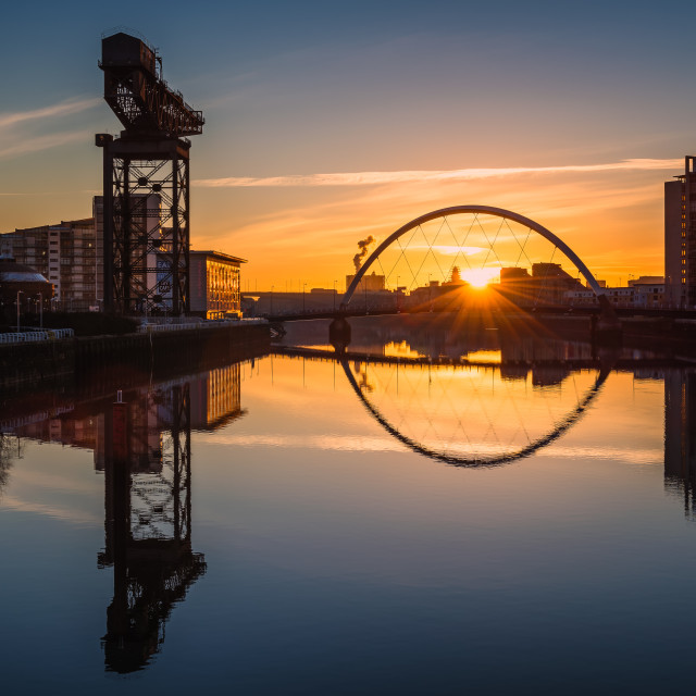 """Sunrise at the Clyde Arc (Squinty Bridge), Pacific Quay, Glasgow, Scotland, UK"" stock image"