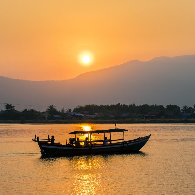 """Boat on the Kampot River at sunset, Kampot, Kampot Province, Cambodia"" stock image"