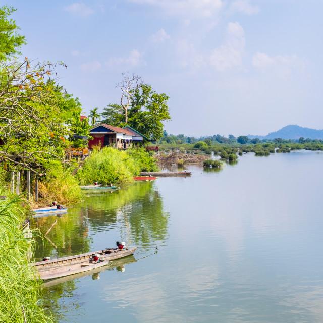 """Buildings along the Mekong river at Don Det, Si Phan Don (Four Thousand..."" stock image"